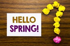 Handwritten text showing Hello Spring!. Business concept for Summer Time Welcoming Written on sticky note paper, wooden background. Handwritten text showing Royalty Free Stock Photography