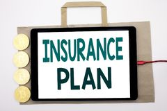 Handwritten text showing Insurance Plan. Business concept writing for Health Life Insured Written on shopping bag and tablet with. Handwritten text showing Stock Photos