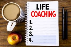 Handwritten text showing Life Coaching. Business concept for Personal Coach Help written on notepad note paper on the wood structu. Handwritten text showing Life Royalty Free Stock Photography
