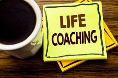 Handwritten text showing Life Coaching. Business concept for Personal Coach Help written on sticky note paper on the wooden wood b. Handwritten text showing Life Royalty Free Stock Image