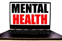 Handwritten text showing Mental Health. Business concept writing for Anxiety Illness Disorder Written on monitor front screen, whi. Te background with space view stock images