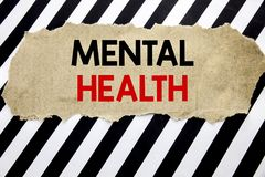 Handwritten text showing Mental Health. Business concept writing for Anxiety Illness Disorder Written on note paper, black backgro. Handwritten text showing stock photos