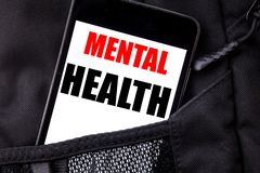 Handwritten text showing Mental Health. Business concept writing for Anxiety Illness Disorder Written phone mobile phone, cellphon. E placed in man front jeans royalty free stock image