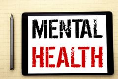 Handwritten text showing Mental Health. Business concept writing for Anxiety Illness Disorder Written on tablet computer screen, w. Hite background office space royalty free stock images
