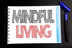 Handwritten text showing Mindful Living. Business concept writing for Life Happy Awareness Written on notepad note paper, black ba. Handwritten text showing Royalty Free Stock Image