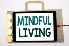 Handwritten text showing Mindful Living. Business concept writing for Life Happy Awareness Written on shopping bag and tablet with. Handwritten text showing Royalty Free Stock Images