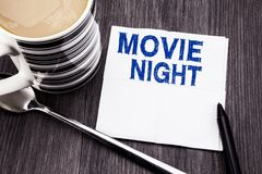 Handwritten text showing Movie Night. Business concept for Wathing Movies written on the tissue paper handkerchief on the wooden. Handwritten text showing Movie stock images