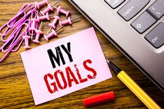 Handwritten text showing My Goals. Business concept for List Plan for Motivation written on pink sticky note paper on the wooden b Royalty Free Stock Photos