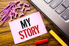 Handwritten text showing My Story. Business concept for Telling Tell About You written on pink sticky note paper on the wooden bac. Handwritten text showing My Royalty Free Stock Image