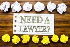 Handwritten text showing Need A Lawyer. Business concept for Advocacy Justice Help Written on sticky note, wooden with sticky, man. Handwritten text showing Need stock photos