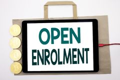 Handwritten text showing Open Enrolment. Business concept writing for Medicine Doctor Enroll Written on shopping bag and tablet wi royalty free stock image