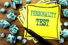 Handwritten text showing Personality Test. Business concept for Attitude Assessment Written on sticky note paper, wooden backgroun. D marker folded yellow paper royalty free stock photography