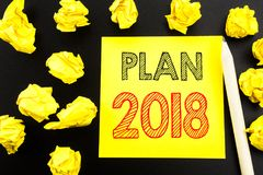 Handwritten text showing Plan 2018. Business concept writing for Planning Strategy Action Plan written on sticky note paper on the. Handwritten text showing Plan Royalty Free Stock Photography