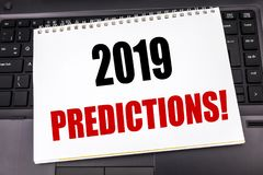 Handwritten text showing 2019 Predictions. Business concept writing for Forecast Predictive written on notepad note paper on the b