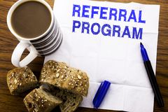 Handwritten text showing Referral Program. Business concept for Refer Marketing written on tissue paper on the wooden background. Handwritten text showing stock photography