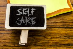 Handwritten text showing Self Care. Business concept for Taking caring for own Health written on announcement board on the wooden. Handwritten text showing Self Stock Photography
