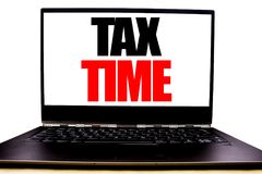Handwritten text showing Tax Time. Business concept writing for Taxation Finance Reminder Written on monitor front screen, white b stock image