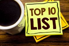 Handwritten text showing Top 10 Ten List. Business concept for Success ten list written on sticky note paper on the wooden wood ba. Handwritten text showing Top Royalty Free Stock Images