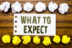 Handwritten text showing What To Expect. Business concept for Achieve Expectation Written on sticky note, wooden with sticky, many. Handwritten text showing What Stock Image