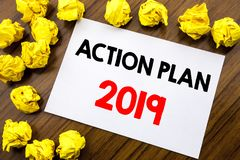 Handwritten text showing word Action Plan 2019. Business concept writing Success Strategy Written on sticky note paper, wooden bac. Handwritten text showing word Royalty Free Stock Photos