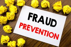 Handwritten text showing word Fraud Prevention. Business concept writing Crime Protection Written on sticky note paper, wooden bac. Handwritten text showing word Royalty Free Stock Photography