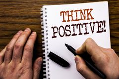 Handwritten text showing word Think Positive. Business concept for Positivity Attitude Written on tablet laptop, wooden background. Handwritten text showing word royalty free stock image