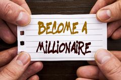 Handwritten text sign showing Become A Millionaire. Business concept for Ambition To Become Wealthy Earn Fortune Fortunate written. Sticky Note Paper Holding Stock Images