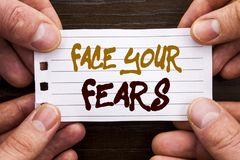 Handwritten text sign showing Face Your Fears. Business concept for Challenge Fear Fourage Confidence Brave Bravery written on Sti. Handwritten text sign showing stock photography