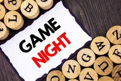 Handwritten text sign showing Game Night. Business concept for Entertainment Fun Play Time Event For Gaming written on White Stick. Handwritten text sign showing royalty free stock photo