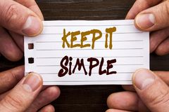 Handwritten text sign showing Keep It Simple. Business concept for Simplicity Easy Strategy Approach Principle written on Sticky N. Handwritten text sign showing Stock Photography