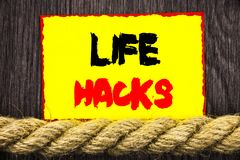 Handwritten text sign showing Life Hacks. Conceptual photo Solution Hacking Hack Trick To Help Efficiency written on Sticky note n. Handwritten text sign showing Royalty Free Stock Photo