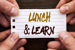 Handwritten text sign showing Lunch And Learn. Business concept for Presentation Training Board Course written on Sticky Note Pape. Handwritten text sign showing royalty free stock image