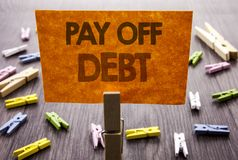 Handwritten text sign showing Pay Off Debt. Business concept for Reminder To Paying Owed Financial Credit Loan Bills written on st. Handwritten text sign showing Royalty Free Stock Image