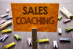 Handwritten text sign showing Sales Coaching. Business concept for Business Goal Achievement Mentoring written on sticky Note on t. Handwritten text sign showing Royalty Free Stock Image