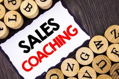Handwritten text sign showing Sales Coaching. Business concept for Business Goal Achievement Mentoring written on White Sticky Not. Handwritten text sign showing Royalty Free Stock Image