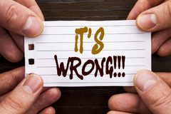 Handwritten text sign showing It Is Wrong. Business concept for Correct Right Decision To Make Or Mistake Advice written on Sticky. Handwritten text sign showing Royalty Free Stock Photo