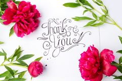 Handwritten Thank you card with flowers. On white paper Stock Photo