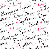 Handwritten vintage ink cursive font pattern with pink watercolor hearts Stock Photos