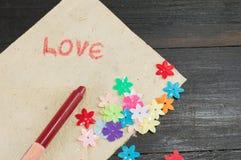 Handwritten word love on paper Stock Photo
