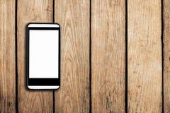 Handy auf Holztischbeschaffenheitshintergrund Stockfoto