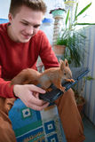 Handy baby squirrel. royalty free stock photography