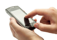 Handy in Ihren Händen Lizenzfreie Stockfotos