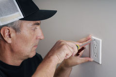Handy man. Close-up image of handy man fixing an electricity outlet Stock Images