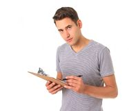 Handy man. Young handy man with clipboard, studio isolated on white stock images