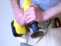 Handy Man. With power tool Stock Photography