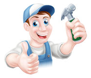 Handy man holding hammer Royalty Free Stock Image