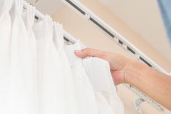 Handy man install curtain Stock Images
