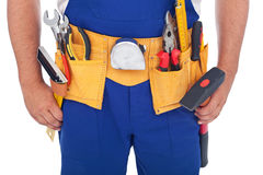 Handy man with lots of tools. Closeup on belt Royalty Free Stock Photo