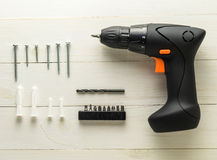 Handy man picture frame installation equipment. Driller Screwdriver for photo frame installing. Stock Photo