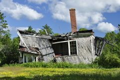Handy Man Special. Abandoned house on verge of collapse in northern Wisconsin.  Shot as if it were for sale and how it might be promoted Royalty Free Stock Images